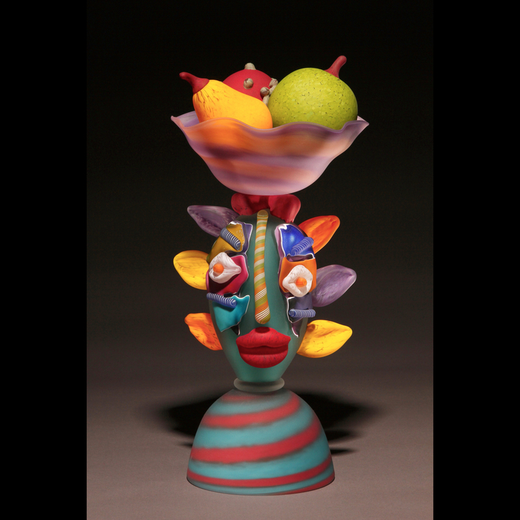 Woman with Fruit Sculpture