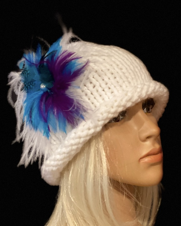 Women's white, rolled brim cloche hat with a feather brooch